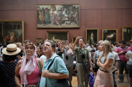 I find the tourists to be just as interesting as the paintings they're looking at.